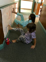 Picture of children doing drawing with their feet for youth coaching and youth mentorship.
