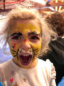 Picture of a child with face painted for youth yoga.